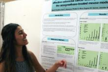 Swati Chandra presenting a poster of her research