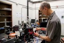 Raymond K. Kostuk exhibits the bench-top VHIS at work in his lab located in the University of Arizona's department of electrical and computer engineering. Photo by Taylor Hudson/Tech Launch Arizona