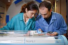 Two Cubresa researchers insert a mouse into the NuPET system on July 28. The UA was chosen as the first U.S. institution to receive the technology; image courtesy of Cubresa Inc.