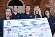 Engineering Design Team 15024 with their project poster