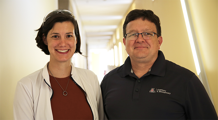 Colleen Janczak and Craig Aspinwall standing together in a brightly lit hallway