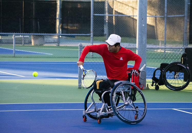 Jason Keatseangsilp playing wheelchair tennis