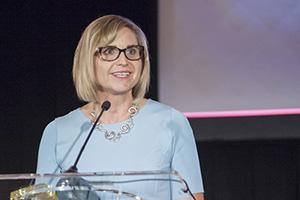 Jennifer Barton onstage after receiving the 2016 SPIE President's Award; photo courtesy of SPIE