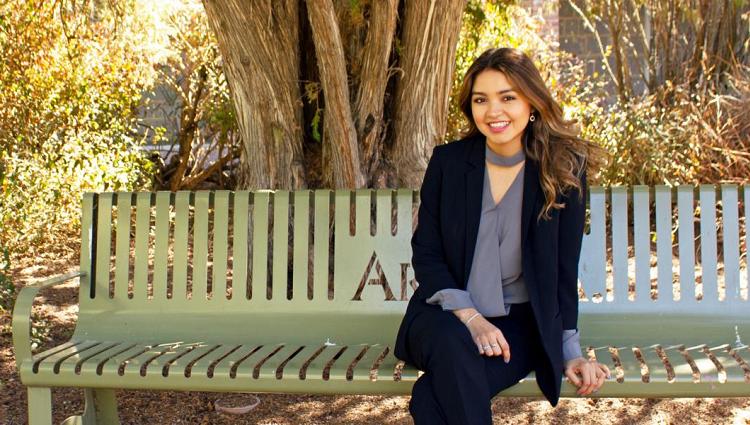 Jocelyne Rivera on a bench