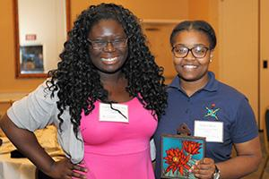 Eugenia Anane-Wae and Ty'Dria White accept the 2016 University Excellence in STEM Diversity Award on Wolfgang Fink's behalf. Photo courtesy of the UA Women in Science and Engineering Program